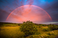 Red Rainbow (Gareth Mon Jones) Tags: rainbow weather sunset anglesey wales