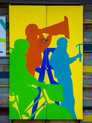 The Shape of Things to Cone (Steve Taylor (Photography)) Tags: thecommons hammer basket helmet stepladder art mural streetart stencil hut shed door yellow orange blue green men newzealand nz southisland canterbury christchurch city silhouette bike rider bicycle