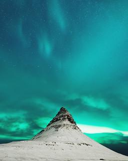 Aurora borealis. Kirkjufell. Iceland.