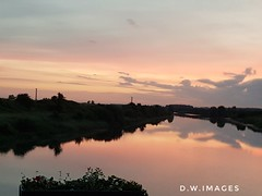 A new day over East Anglia fens at Downham market uk (madmax557) Tags: sunrise eastanglia fens reflection reflections uk england river rivers startofanewday anewday greatbritain outwalking outdoors thegreatoutdoors outandabout outside earlymorning outsidephotos