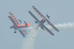 Flying through the smoke! (davepickettphotographer) Tags: imperialwarmuseum duxford iwm airshow england flight flying display uk cambridgeshire cambridge aviation aircraft httpwwwaerosuperbaticscom wingwalkers wingwalking