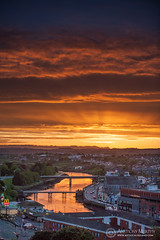 Drogheda sunset and red sky (mythicalireland) Tags: sunset setting sun red sky clouds river reflection town bridges boyne valley louth drogheda