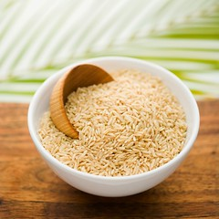 Grain in a White Ceramic Bowl (perfectionistreviews) Tags: asian bowl brownrice cuisine cup dish food grain healthylifestyle highangle indoors ingredient inside nobody nutrition organic raw rice scoop selectivefocus square stilllife studio uncooked wood wooden color photograph foodanddrink