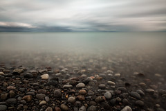 down here with the rocks and stones (Marc McDermott) Tags: longexposure beach water lake ontario canada clouds stones rocks calm tranquil