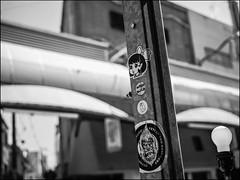 Yeti (David Panevin) Tags: 新世界 shinsekai 大阪 osaka kansai japan olympus omd em1 leicadgsummilux25mmf14asph street signs graffiti sticker tag りんご shops urbanfragments blackandwhite bw japaninbw bokeh bokehlicious davidpanevin