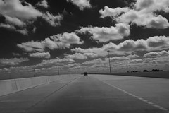 Overpass {151/365} (therealjoeo) Tags: 365 texas sky clouds blackandwhite highway tollroad overpass truck pickup