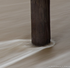 Disturbing the Waves (David J. Greer) Tags: north carolina outer banks beach seashore waves piling blur blurred recede disturb sentinel