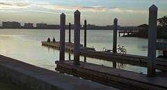 People & Bicycle (Nikon S2, 1956) (PositiveAboutNegatives) Tags: nikon rangefinder vintage nikons2 50mm nikkor film analog agfavista200 coolscan lakeworth florida morning sunrise firstlight