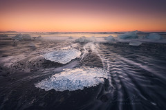 Ice on the black volcanic beach near Jokulsarlon glacier lagoon, winter Iceland (Daniel Viñe fotografia) Tags: beach jokulsarlon iceland glacier volcanic ice beautiful black lagoon sunset blue icelandic white winter water travel landscape vatnajokull sea ocean cold frozen light nature glacial