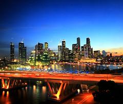 Singapore Skyline (` Toshio ') Tags: toshio singapore asia asian skyline cityscape city dusk bluehour architecture buildings bridge canon canon30d 30d sunset