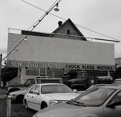 Chuck Bleeg Motors, Portland, Oregon (austin granger) Tags: chuckbleeg portland oregon carlot used leasing sign sales billboard blank wires street dealership usedcarlot square film gf670