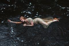 Where the dark rivers flow. (aleah michele) Tags: water waterfall beautiful broken bubbles dark dress delicate deep dream dance darkness redhair conceptual conceptualportrait concept
