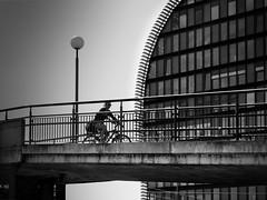 cyclist in the city (heinzkren) Tags: schwarzweis blackandwhite sw monochrome panasonic lumix urban sport bridge brücke radweg way building gebäude wien vienna architektur architecture street streetphotography bicycle bw