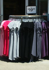 Colors & Stripes (jHc__johart) Tags: dress garment rack sign stripes color sidewalk door okcoutletshoppes oklahoma number