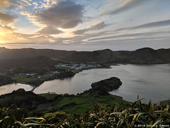 Looking Over Sete Cidades Lake (David J. Greer) Tags: sailtrainexplore rubicon3 san miguel azores portugal winter travel adventure visit tourism dusk sunset reflections green lake lagoa das sete cidades still peaceful sky hills clouds weeds tree dramatic bridge landscape