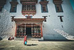 Bhutan: Life Impressions I. Rinpung Dzong. (icarium.imagery) Tags: canoneos5dsr bhutan architecture artwork buddhist captureone canonef1635mmf4l drukyul dzong fortress localpeople mahayanabuddhism monk naturallight parodzong rinpungdzong robe traditionalclothing traditionaldress woodcarving sundaylights