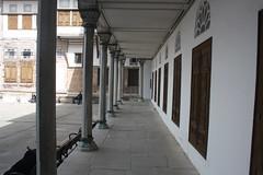 The Harem (lazy south's travels) Tags: turkey turkish istanbul corridor path building architecture museum tourist tourism pillar yard door