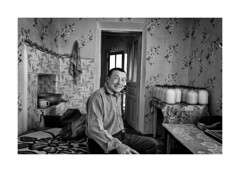 In the army I served in Leipzig (Jan Dobrovsky) Tags: ukraine southwestern monochrome blackandwhite portrait leicaq indoor rural village reallife countryside countrylife milk smile