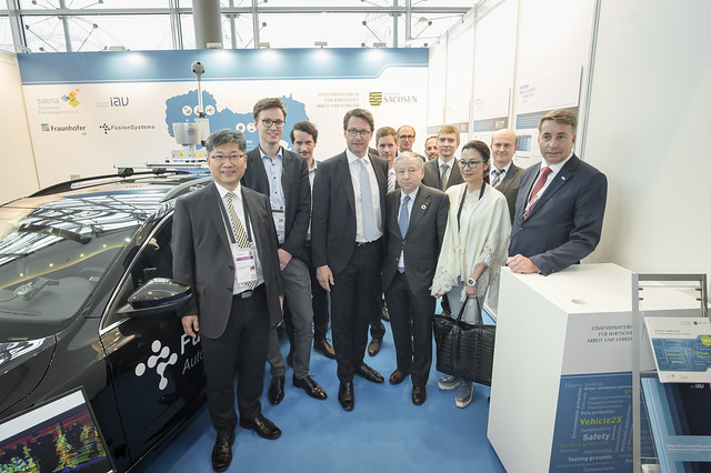 Young Tae Kim, Joseph Löser, Andreas Scheuer, Jean Todt, Michelle Yeoh and Uldis Augulis visit the Saxony stand