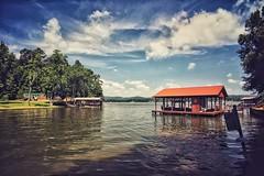 Weiss Lake   Centre, Alabama (steveartist) Tags: lakes weisslake centrealabama sky clouds boathouses water waves iphonese snapseed snapseedfilters vintagelook filmlook stevefrenkel