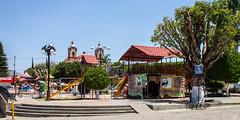 Parque Infantil de Zimatlán de Álvarez (lucico) Tags: 2013 méxico oaxaca day zimatlándeálvarez playground church zocalo iglesia igreja lamp steps sign