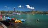 Puffy Clouds (Jocey K) Tags: bankspeninsula newzealand nikond750 akaroa hills sea akaroaharbour scene seascape trees clouds sky people boats ships cruiseships water kayak