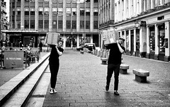 📦 +📦 (Mister G.C.) Tags: street urban photography blackandwhite bw olympus xa2 olympusxa2 dzuiko zuikolens f35 35mm primelens fullframe kodakgold200 compactcamera compact camera zone focus zonefocusing streetphotography urbanphotography shot image photograph candid people men guys boxes parcels carrying eyecontact monochrome town city analog analogphotography analogue film filmcamera schwarzweiss strassenfotografie mistergc glasgow scotland europe