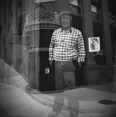 East Village neighborhood man and old bank (Meredith Jacobson Marciano) Tags: lomography dianaf eastvillage doubleexposure architecture blackandwhite 120mm expired oldfilm film analog 7dwf