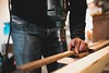 Man Holding Wooden Stick While Drilling Hole - Credit to http://homedust.com/ (Homedust) Tags: adult artisan business carpentry craft drill drilling man tools wood woodworking workbench workplace workshop