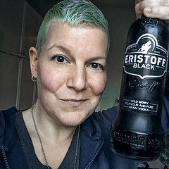 One birthday gift of many (Melissa Maples) Tags: brussel bruxelles brussels belgique belgië belgium europe apple iphone iphone6 cameraphone winter square 11 me melissa maples selfportrait woman shorthair bluehair greenhair alcohol bottle black eristoffblack vodka drink food