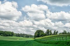 In Leutstetten, Bayern (Janos Kertesz) Tags: agriculture clouds bayern bavaria leutstetten landscape nature sky tree grass green countryside field blue land meadow season rural