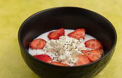 Plain yoghurt with whipped cream, strawberries and chia seeds. (annick vanderschelden) Tags: plain yoghurt plainyoghurt black cream whippedcream dairy yellow food dessert filled strawberries sliced fruit chiaseeds belgium