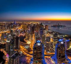 Dubai Sunset (Siebring Photo Art) Tags: cayantower dubai dubaimarina dubaiskyline emirates uae mirrorimage rooftop sunset verenigdearabischeemiraten ae
