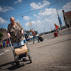 Rollator and travel bags @ Centraal Station (PaulHoo) Tags: fujifilm x70 2018 candid streetphotography amsterdam city urban citylife people rollator old disabled handicap contrast juxtaposition hipshot