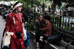 lady in red (spanaut) Tags: street newyork unitedstates us woman red raincoat couple teenage love unionsquare candid streetphotography