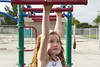 Monkey Bar Girl (aaronrhawkins) Tags: playground girl monkeybars equipment play stretch reach exercise little cute strong arms clara utah school colorful hang child young sweet pretty niece family aaronhawkins riverton determination goal achievement