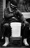 Scratch that itch. (Neil. Moralee) Tags: neilmoralee usa2017neilmoralee man street new orleans usa candid hat beard itch scratch bucket begging busking old mature black white bw bandw blackandwhite mono monochrome glassess dark nikon d7200 neil moralee
