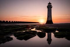 Night Guard (Mark Boadey) Tags: fortperchrock lighthouse newbrighton rocks sunset