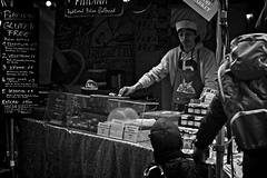 Glance (garryknight) Tags: sony a6000 on1photoraw2018 london southbank blackandwhite mono monochrome themonoseries street candid food flatbread italian market stall stallholder boy allrightsreserved