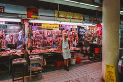 Butcher (nachomaans) Tags: hongkong meat market street stall butcher fuji xt20 xf23 steak chops pork beef ribs boots offal city business shop apron chinese leg hk causewaybay neon fluorescent tube
