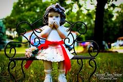 Little Girl on a bench / New Jersey (SevenOneSeven MamboDan) Tags: statue newjersey outdoorsornament littlegirlornament red macrophotography littlegirlsittingonbenchstatue lawnornament yardornament gardenstatue