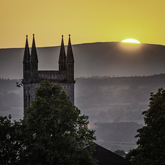 Sunset over St James (Swirly_Magnolia) Tags: st james church clitheroe lancashire sunset sun down set colour color orange steeple tower birds dusk pigeons town nikon tamron country countryside uk england bright warm religious christian christianity christ flock trees hills