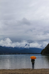 Rainy (CoolMcFlash) Tags: weather cloud sky umbrella orange person woman lake water cloudscape landscape canon eos 60d wolfgangsee austria wetter regen rain wolke bewölkt cloudy himmel regenschirm absence frau see wasser landschaft österreich fotografie photography tamron b008 18270 gebirge berg mountain nature natur