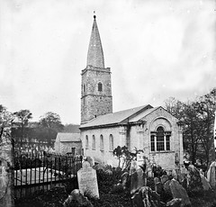 """""""Church with square tower of rubble masonry"""" is the original St Finbarre's Cathedral, Cork (National Library of Ireland on The Commons) Tags: thestereopairsphotographcollection lawrencecollection stereographicnegatives jamessimonton frederickhollandmares johnfortunelawrence williammervynlawrence nationallibraryofireland churchyard headstones tombstones steeple church windows marylucey locationidentified cork cathedral saintfinbarrescathedral saintfinbarres gotcork bishopsstreet cathedralquarter ashabbyapologyforacathedral probablycataloguecorrection possiblecataloguecorrection"""