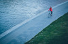 Red (freyavev) Tags: red woman bike bicycle vilnius lithuania baltic capital capitalcity quay riverbank nerisriver telelens canon canon700d vsco mikasniftyfifty water evening outdoor urban city minimalism
