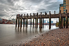 OXO Jetty (Geoff Henson) Tags: london jetty pier river water sky clouds skyline skyscrapers cathedral longexposure beach pebbles people
