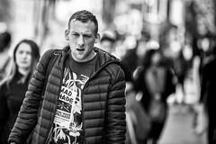 Serious looking (Frank Fullard) Tags: frankfullard fullard candid street portrait monochrome blackandwhite blanc noir dublin face expression serious frown irish ireland