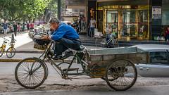 Taking a break in Xi'an (Sean Lancaster) Tags: fe sony a7rii sonya7rii xianchina xian bike worker resting 55 5518 fe55 explore