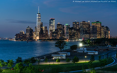 Twilight View from Governors Island (20180525-DSC07575-Edit) (Michael.Lee.Pics.NYC) Tags: newyork governorsisland thehills lowermanhattan aerial newyorkharbor wtc onewtc worldtradecenter architecture cityscape skyline night twiight dusk bluehour park sony a7rm2 fe24105mmf4g