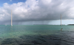 """""""This one's called 'At distance from tropical rain, with ocean powerlines,'"""" I clucked insufferably as I took pictures. (Tim Kiser) Tags: 2017 20170413 april april2017 atlanticocean atlanticoceanlandscape florida floridabay floridabaylandscape floridakeys floridakeyslandscape floridalandscape gulfofmexico gulfofmexicolandscape img7824 indiankeyfill islamorada islamoradaflorida islamoradalandscape monroecounty monroecountyflorida overseashighway southerncoastandislands teatablekeychannel us1 ushighway1 usroute1 boat coastlandscape coastallandscape coastlinelandscape distantboat distantrain electriclines electricpoles landscape oceanlandscape overheadelectriclines overheadpowerlines partlysunny powerlines rain raincloud rainylandscape seascape southflorida southernflorida telephonepoles tropicallandscape tropicalrain utilitypoles"""